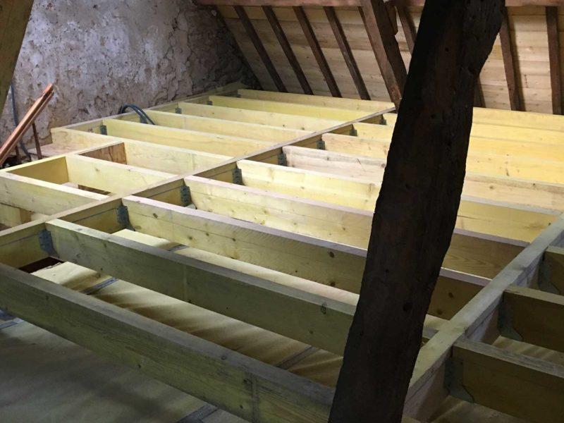 Empoutrellement maison colombage pour la création de combles